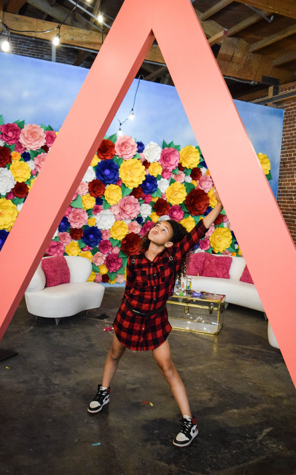 almay influencer event brand activation happy place fgpg young girl flower wall