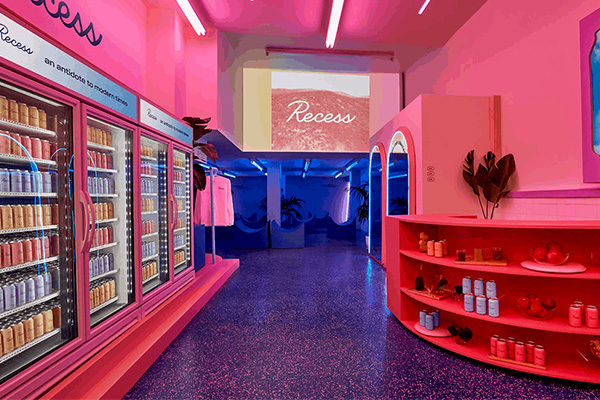 recess irl merch pop up shop with product displayed in fridges