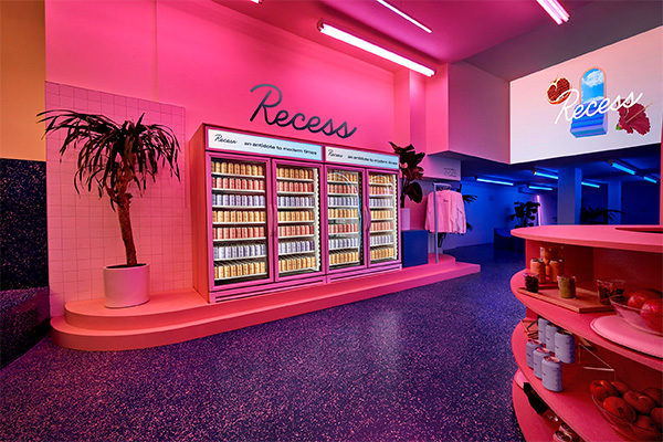 recess pop up shop with pink walls and palm trees