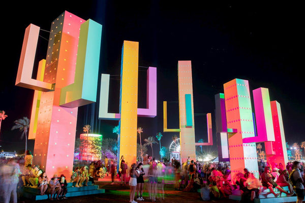 bright colored large cactus sculptures at coachella nighttime