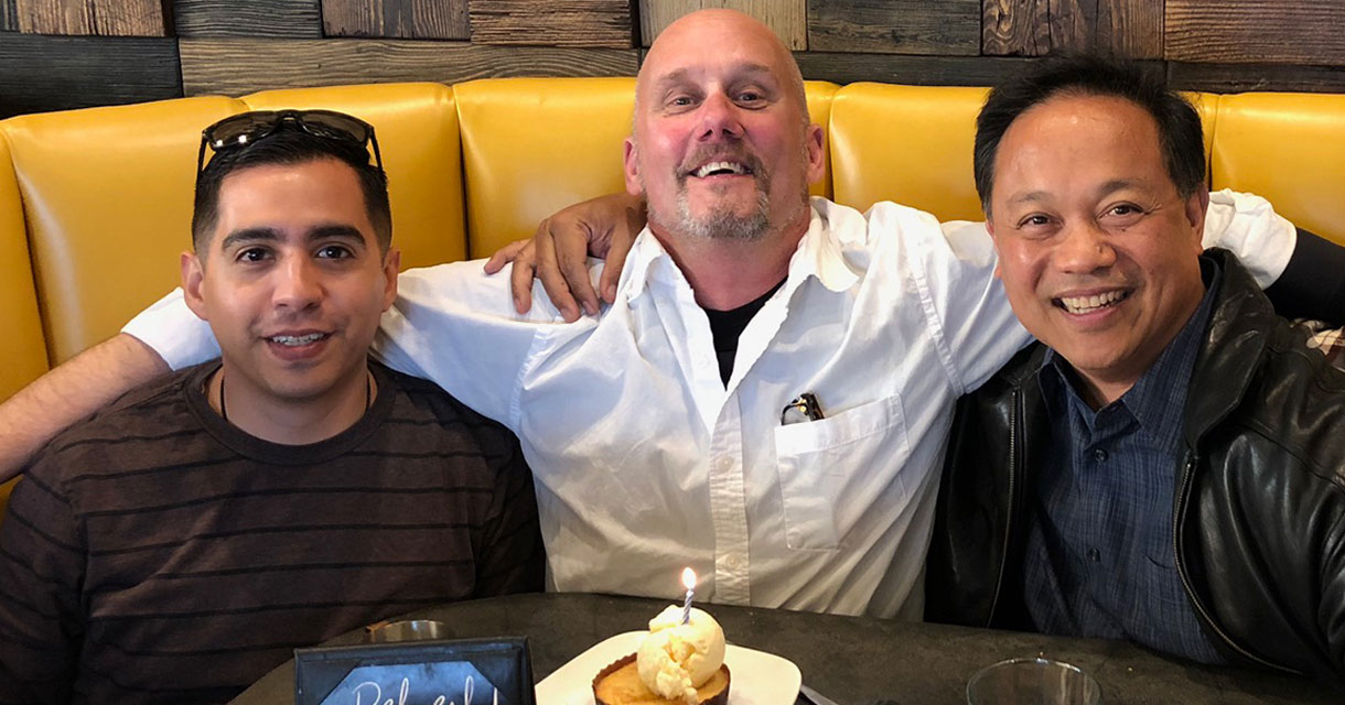 fgpg employees celebrating a birthday over lunch
