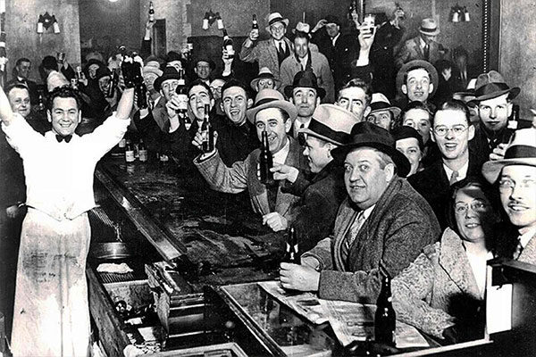 people celebrating the end of prohibition in a bar